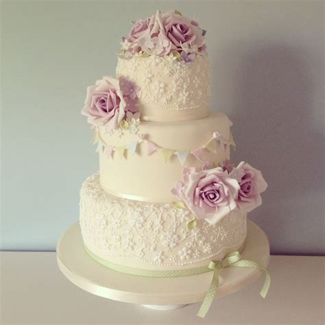 A Beautiful Three Tier Ivory Wedding Cake Finished With