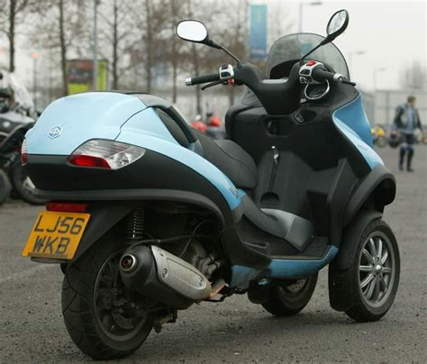 piaggio mp    review speed specs prices mcn