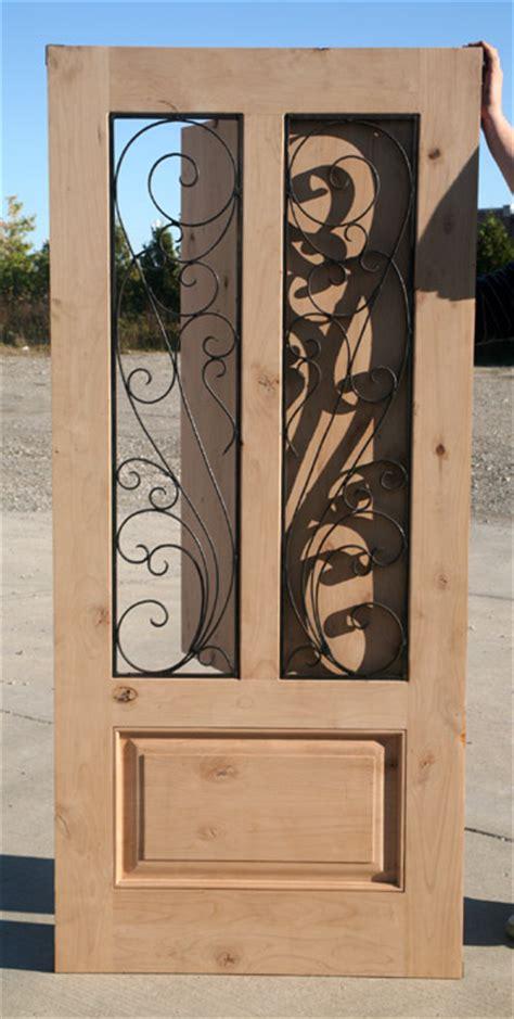 exterior rustic door  wrought iron venting grills