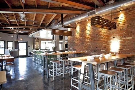 brick cuisine exposed brick light wood cement floors and metal