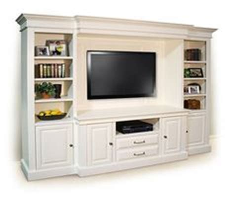 custom white wall unit with bookshelves a customer favorite in southern white built in custom entertainment center for the home