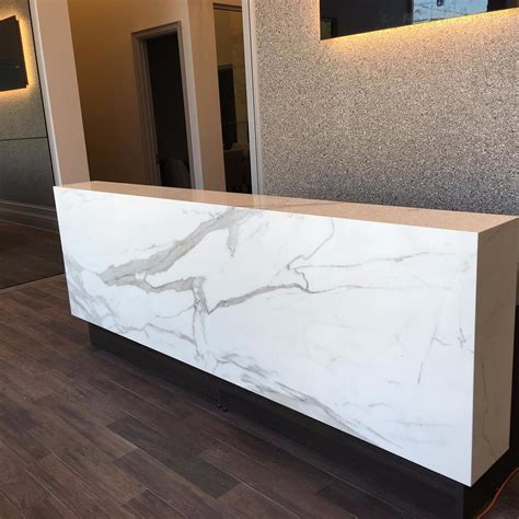 Reception Desk: Neolith Estatuario E05   Marble Trend