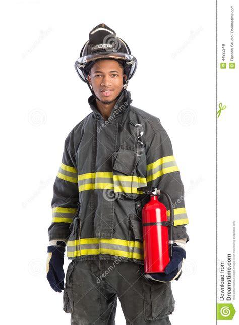 firefighter  uniform holding fire extinguisher stock