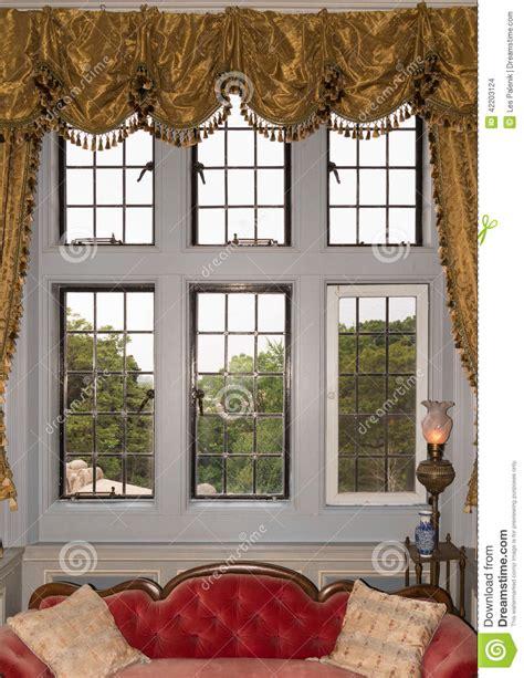 oldfashioned window  drapes stock photo image