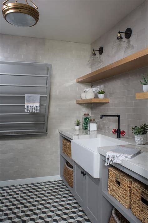 Industrial Style Laundry Room with Gray Tiles