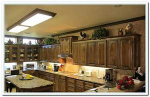 Tips for kitchen counters decor home and cabinet reviews for Kitchen colors with white cabinets with steve mcqueen wall art