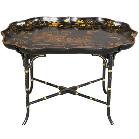 A coffee table does a lot of work. Shaped Lacquer Tray Table - Jayne Thompson Antiques Inc.