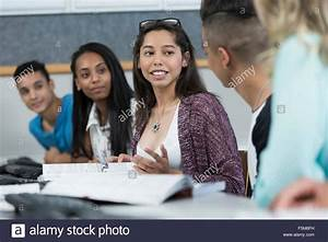 Row of high school students talking in class Stock Photo ...
