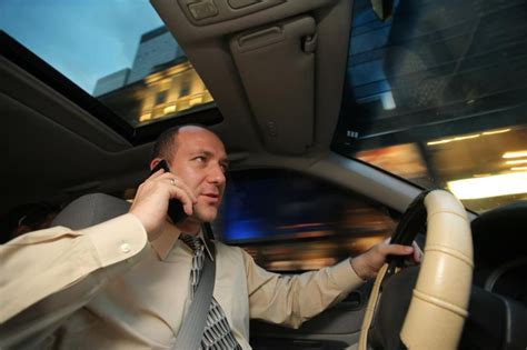 while on the phone hold the phone new study says talking and driving not as