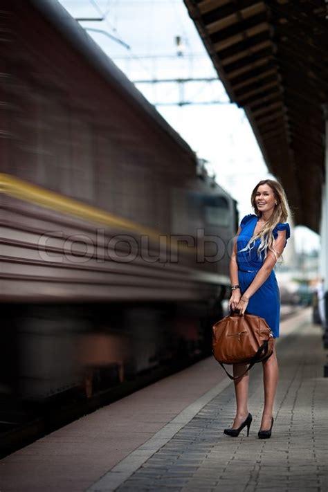 attractive lady waiting train   platform  railway
