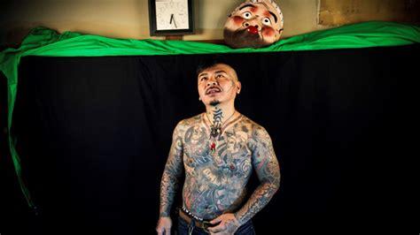 tattoos  give japan  needle  olympics loom