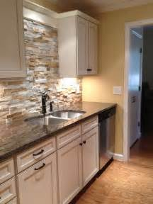 stone kitchen backsplash with white cabinets design