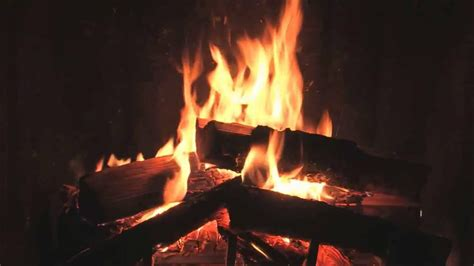 traditional yule log fireplace with crackling sounds