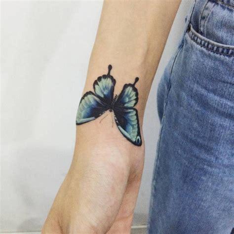 elegant upside  wrist tattoos