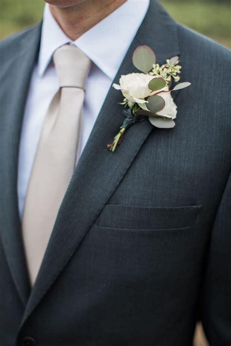white rosebud eucalyptus leaves boutonniere groom