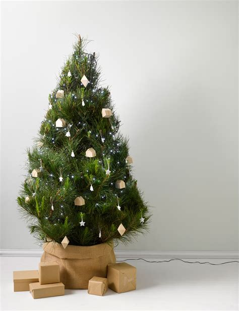 what to use at base of christmas tree four hacks for hiding that unsightly tree base