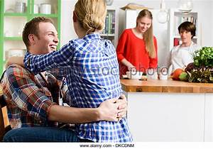 German girl couple in the kitchen