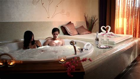 tub couples excited of friends enjoying a pool at