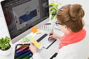 516728032 | Graphic designer at work. Color swatch samples ...