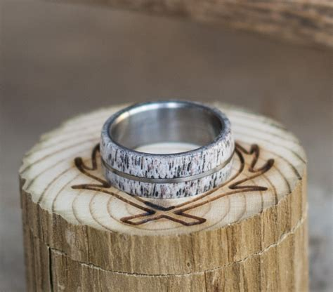 antler wedding band available in titanium silver or gold staghead designs