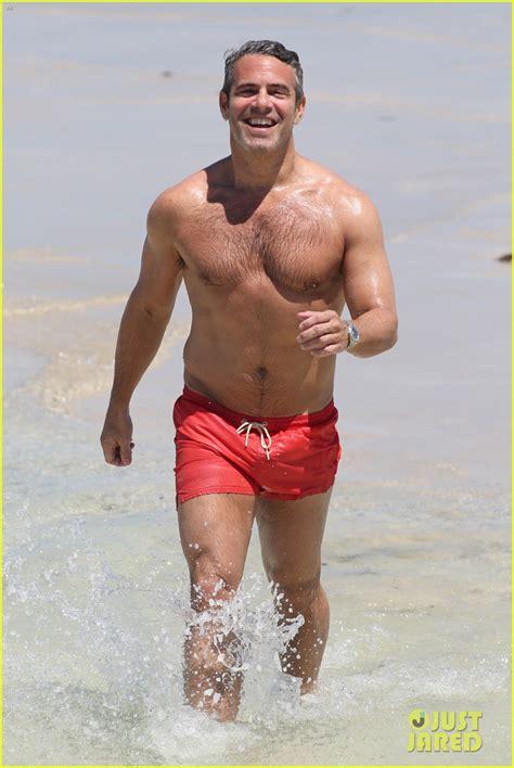 shirtless andy cohen takes  splash  miami beach photo