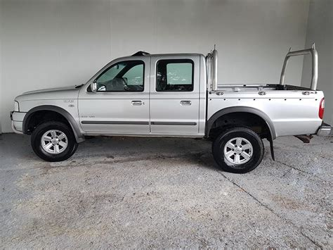 sold automatic dual cab ute  ford courier  silver