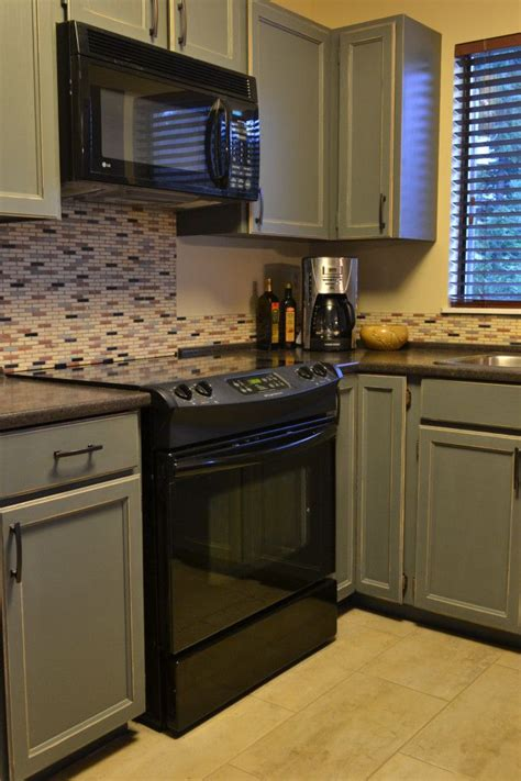 gray distressed kitchen cabinets how to distress painted wood furniture or cabinets 3918