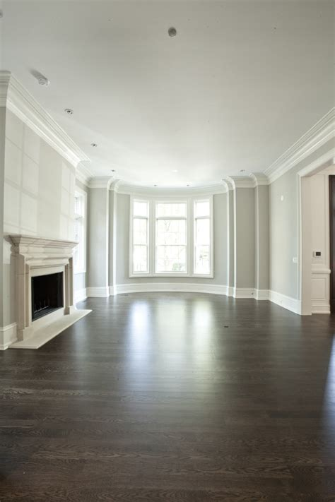 white floors grey walls dark hardwood floors with light gray and white walls add in the fireplace and i m totally