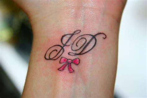 initials wrist tattoos
