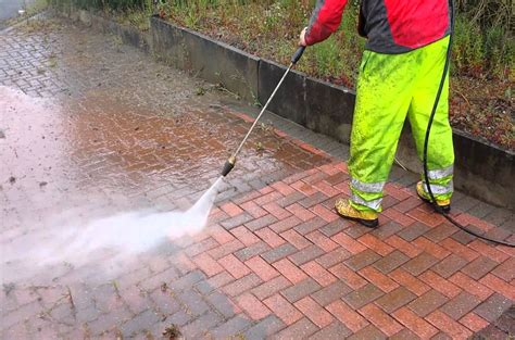how to pressure wash your concrete or brick driveway all