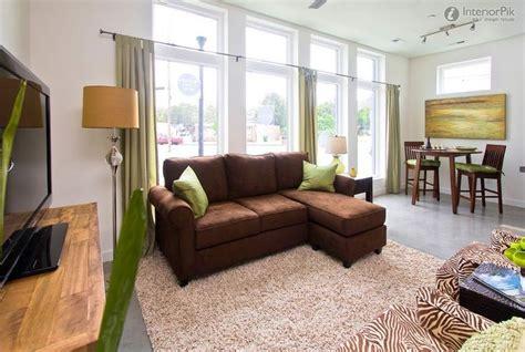 yellow sofa  tan walls wall color  brown