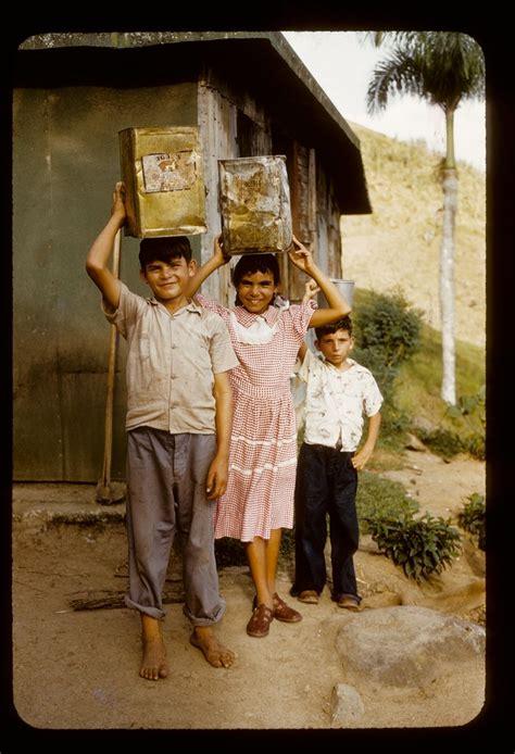 children carrying water children posing  water tins