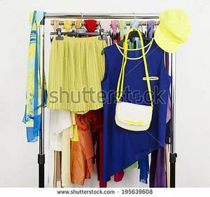 Cute Neon Green And Blue Outfit Displayed A Rack