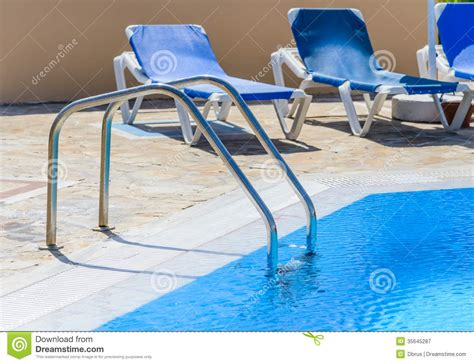 a swimming pool with sun loungers stock image image