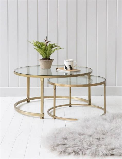 Crafted from a chrome and iron frame, it showcases a golden hue and circular design on the two shorter edges of the table. 2019 Best of Glass Gold Coffee Tables