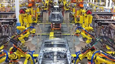 Building A Car by Robots Building Cars
