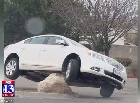 utah drivers  hitting large rock  middle  parking