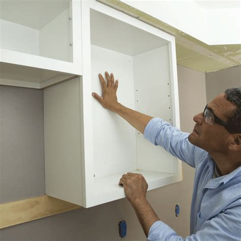 how to hang kitchen cabinets install upper cabinets