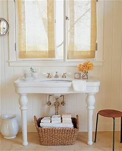 Shelf placed just underneath the mirror adds a place for for Martha stewart bathrooms