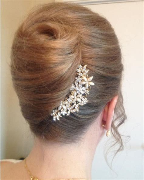 simple rolled pleated updo hairstylescut