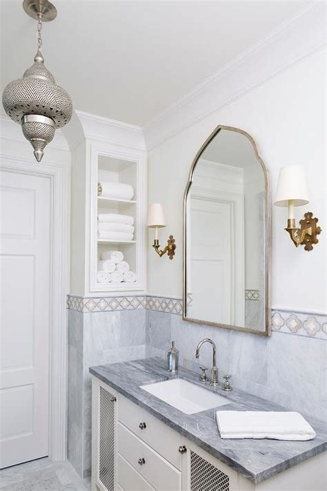 white  gray moroccan style bath  gold accents