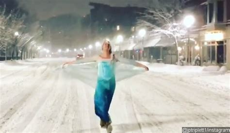 man dressed  elsa rescues  wagon stuck   snow
