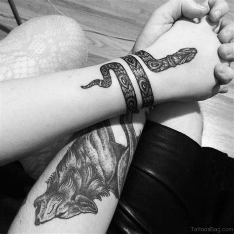 unique snake tattoos  wrist