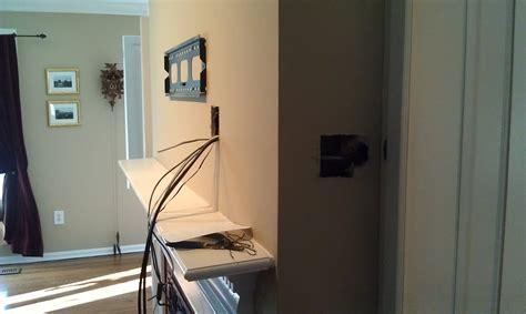 woodbridge ct tv mounted  fireplace  wires hidden