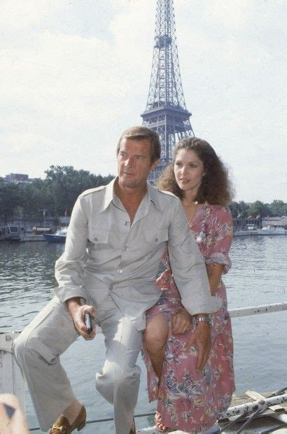 Co-stars Roger Moore, left, and Lois Chiles pose by the ...