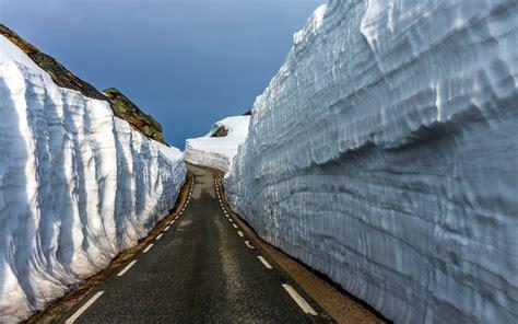 nature landscape winter snow road rock walls