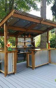 27 best outdoor kitchen ideas and designs for 2018 With kitchen colors with white cabinets with outdoor wall and fence art