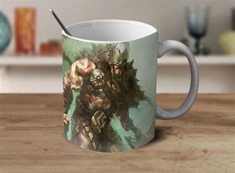 The mug starts as a plain black colored mug then slowly reveals the photo after you poor warm coffee or tea in it. Garruk Magic the Gathering Coffee Mug Color Changing Mug Cup Gamer Gifts - Mugs