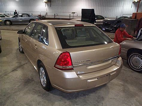 2004 Chevy Malibu Gas Fuel Filler Lid Door Bronze 2595123