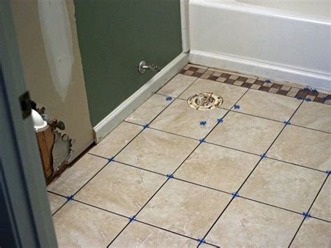 How To Lay A Tile Floor In A Bathroom by How To Install Bathroom Floor Tile How Tos Diy
